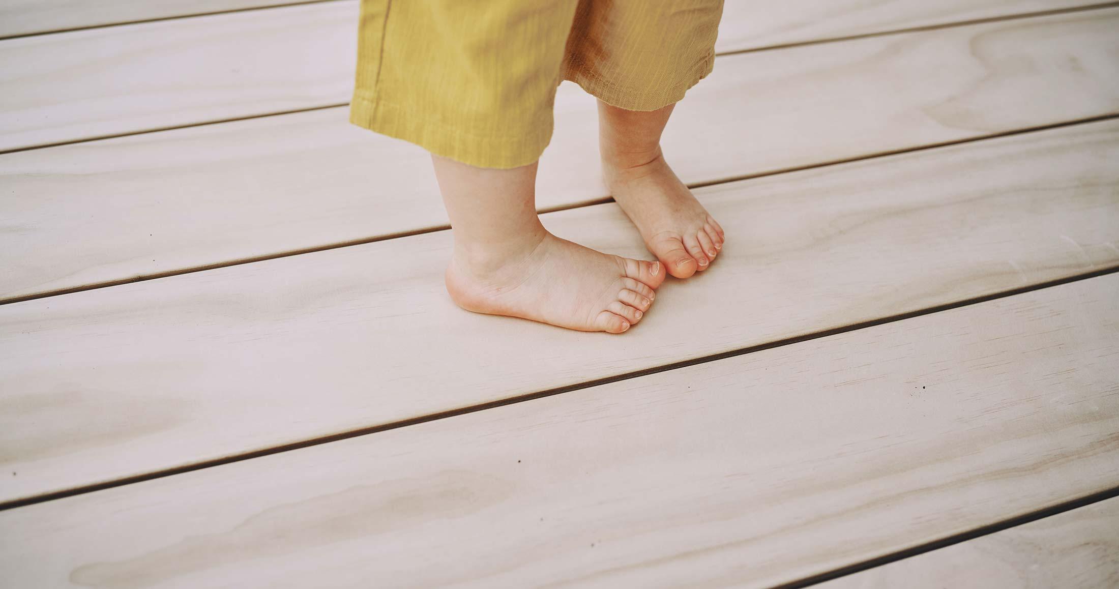 Child's feet on wide board Accoya decking