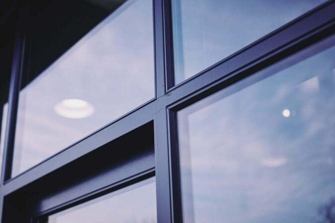 Dark accoya wood window