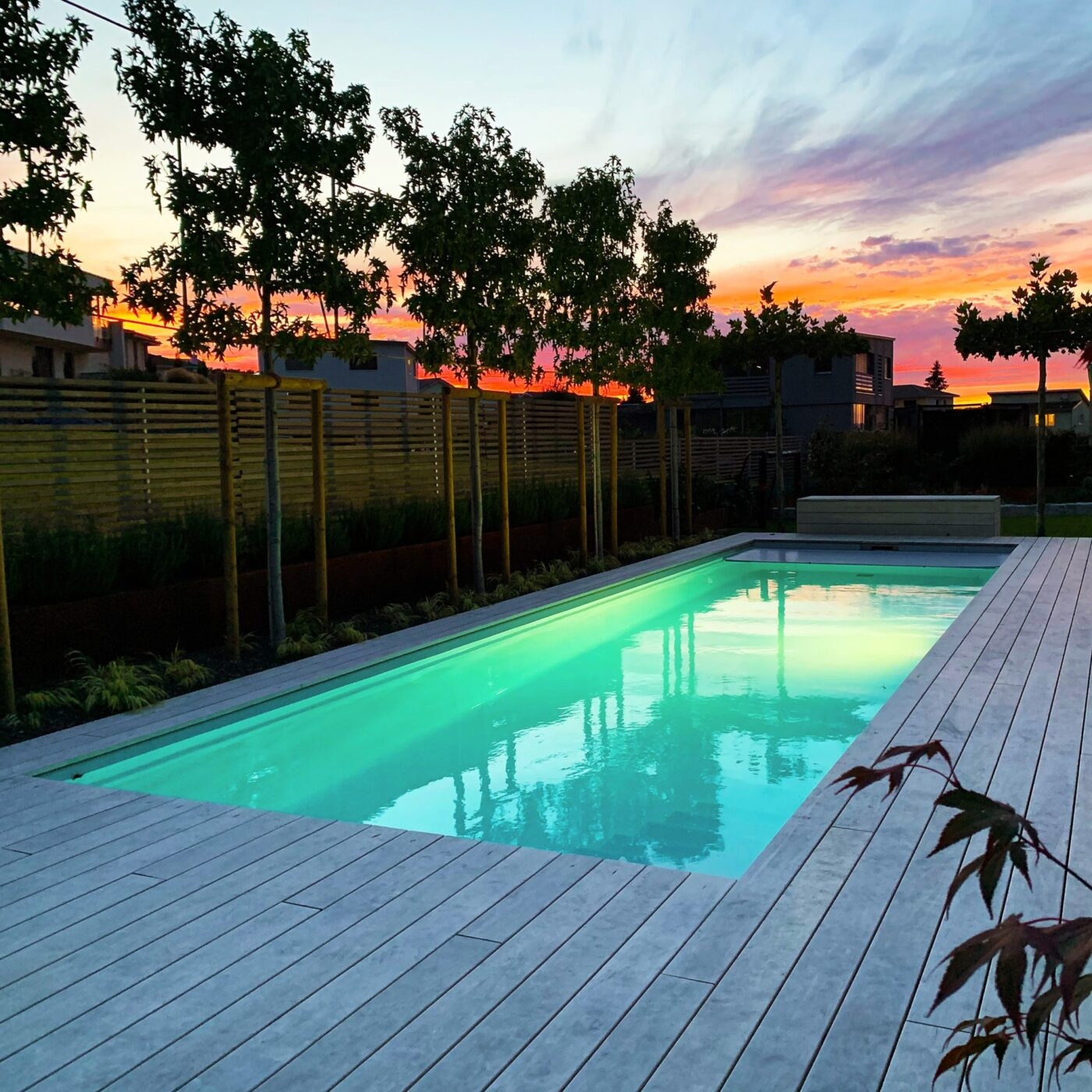Swimming pool surrounded by wood decking
